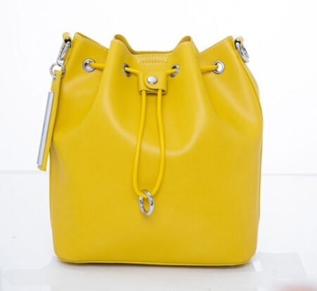 Yellow ladies bag before applying clipping path service