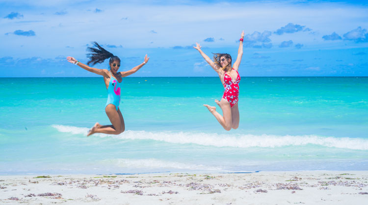Two girl in jumping female poses